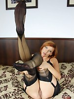 Redhead in black girdle and nylons