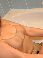 Paige lets her fetish side run wild gets in to the shower fully clothed and has a pee.