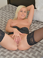 Playful mommy Vanessa Hell teases her pretty pink twat until she cums