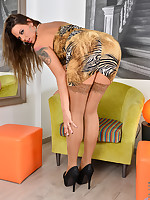 Simony Diamond with long legs bends over and spreads her twat wide open