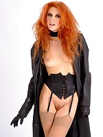 Fiery redhead Chiara flashes her hot body in leather trench coat, corset and knee high boots